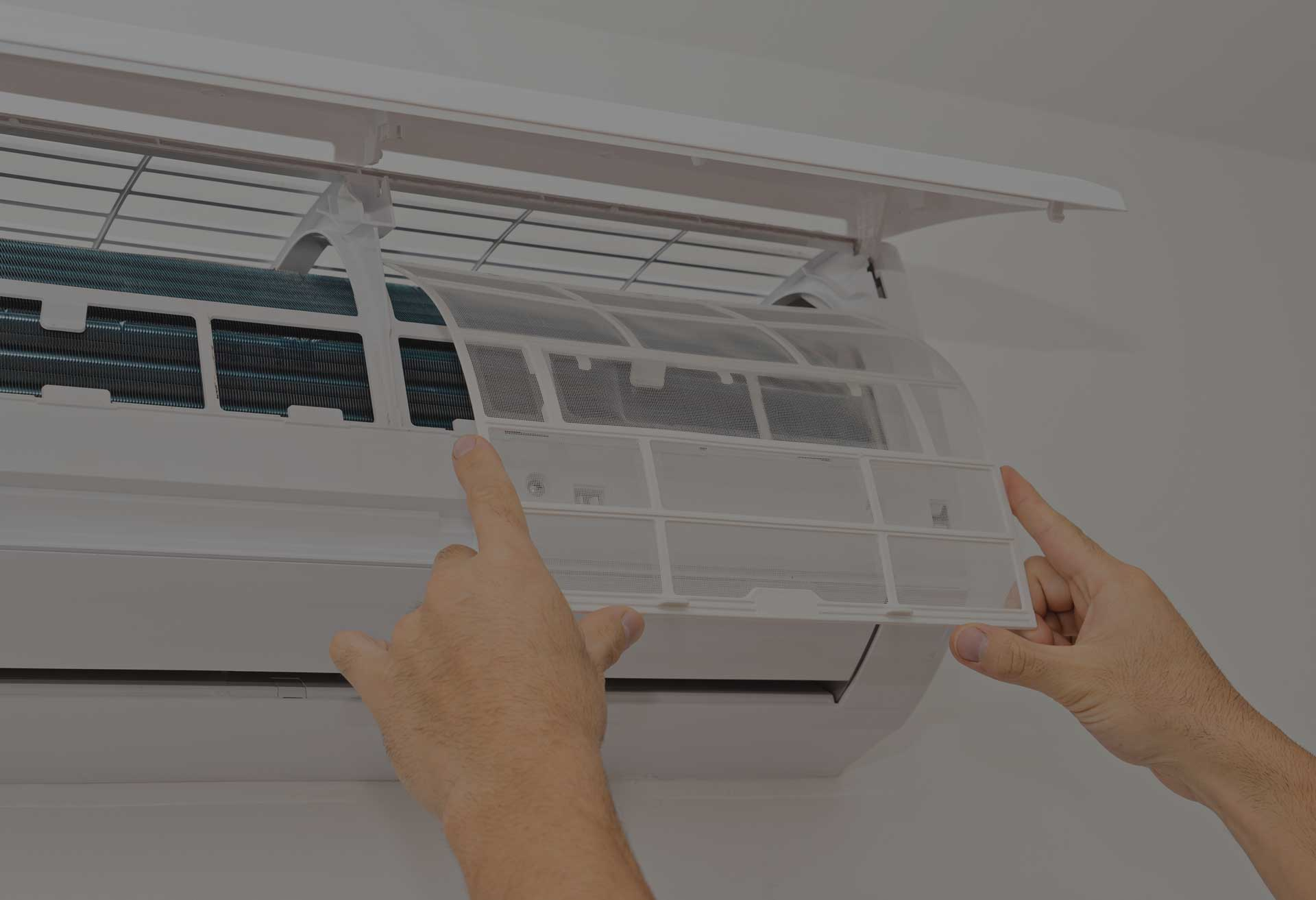 person placing screen on heater